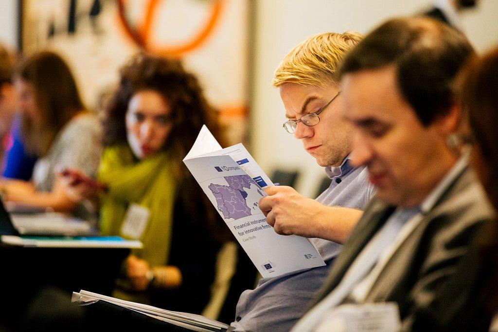 Event participant reading a fi-compass case study