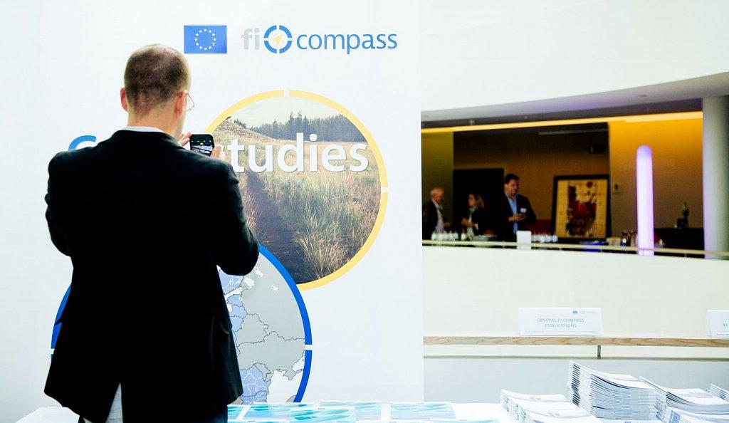 Event participant selecting fi-compass publications
