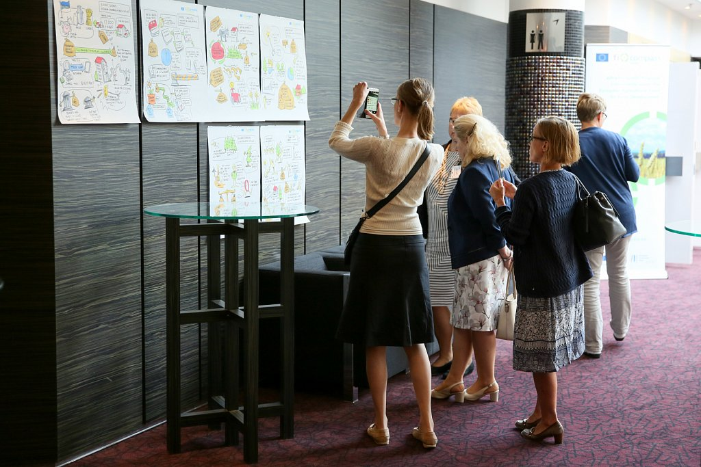 Event participants taking a look at illustrations