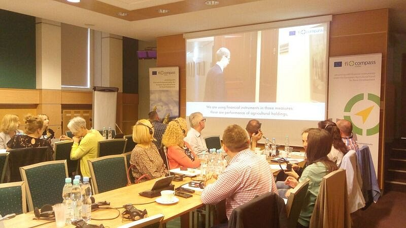 Participants watching a fi-compass case study video
